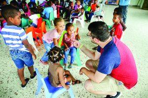 Dr. Carlos Feller, adjunct instructor of music, visits with children at Iglesia Bautista El Sendero (El Sendero Baptist Church) in Santo Domingo.